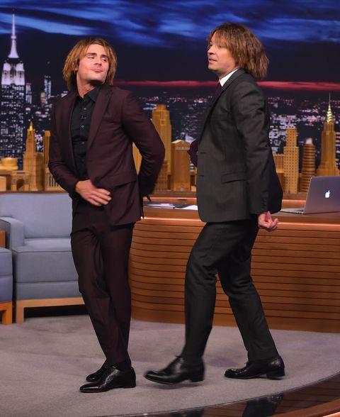 Leg, Suit trousers, Conversation, Blazer, Television presenter, Television program, Laptop,