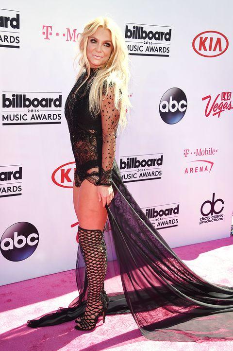 Style, Pink, Fashion model, Logo, Fashion, Magenta, Thigh, Blond, Boot, Long hair,