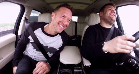 Smile, Car seat, Vehicle door, Jaw, Head restraint, Thumb, Cool, Seat belt, Watch, Passenger,