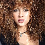 Hair, Lip, Brown, Hairstyle, Chin, Jheri curl, Eyebrow, Ringlet, Style, Beauty,