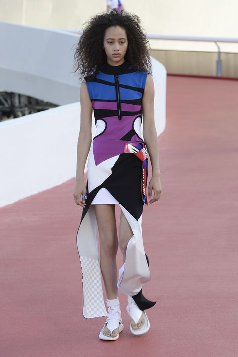 Hairstyle, Skin, Shoulder, Dress, Human leg, Joint, White, Fashion show, Style, Flooring,