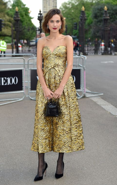 <p>Who: Alexa Chung </p><p>When: May 23, 2016 </p><p>Why: Why is it that we never find gems like Alexa Chung's vintage dress while secondhand shopping? She kept her look modern with a patent O-ring bag and windswept hair at the gala celebrating the Vogue 100 Festival in London, England.</p>