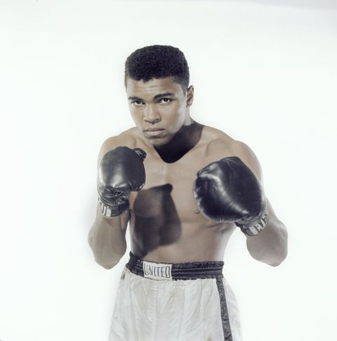 Boxing glove, Arm, Boxing, Glove, Human body, Professional boxer, Boxing equipment, Sports uniform, Sports equipment, Sports gear,