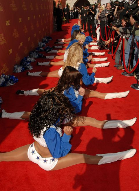 <p>Split and repeat on the step-and-repeat? The Cowboys cheerleaders came to perform during the show, but they apparently couldn't wait to kick things off right outside the event. </p>