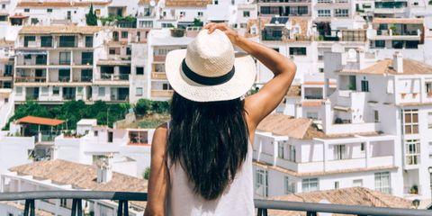 Hat, Shoulder, Back, Headgear, Residential area, Fashion accessory, Sun hat, Street fashion, Beige, Apartment,