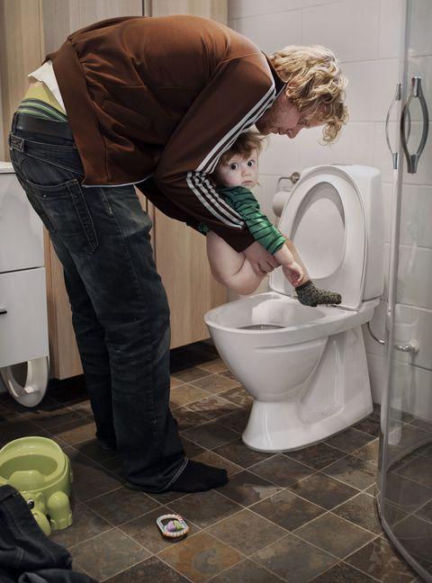 Denim, Bag, Floor, Plumbing fixture, Luggage and bags, Tile, Plumbing, Toilet, Pocket, Bathroom,