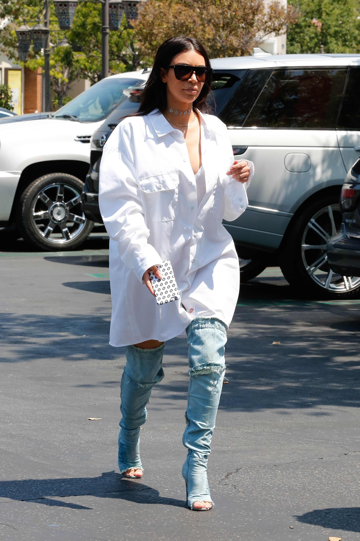 c7fe0d80bd7d0 Kim Kardashian in Hoodie and Biker Shorts - Kim Kardashian Fashion Photos