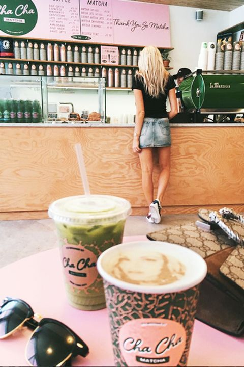 Green, Drinkware, Human leg, T-shirt, Cup, Shorts, Logo, Drink, Denim, Coffee,