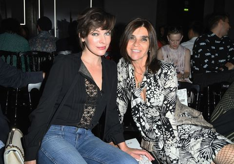 PARIS, FRANCE - JULY 06:  Milla Jovovich and Carine Roitfeld attend the Elie Saab Haute Couture Fall/Winter 2016-2017 show as part of Paris Fashion Week on July 6, 2016 in Paris, France.  (Photo by Pascal Le Segretain/Getty Images)