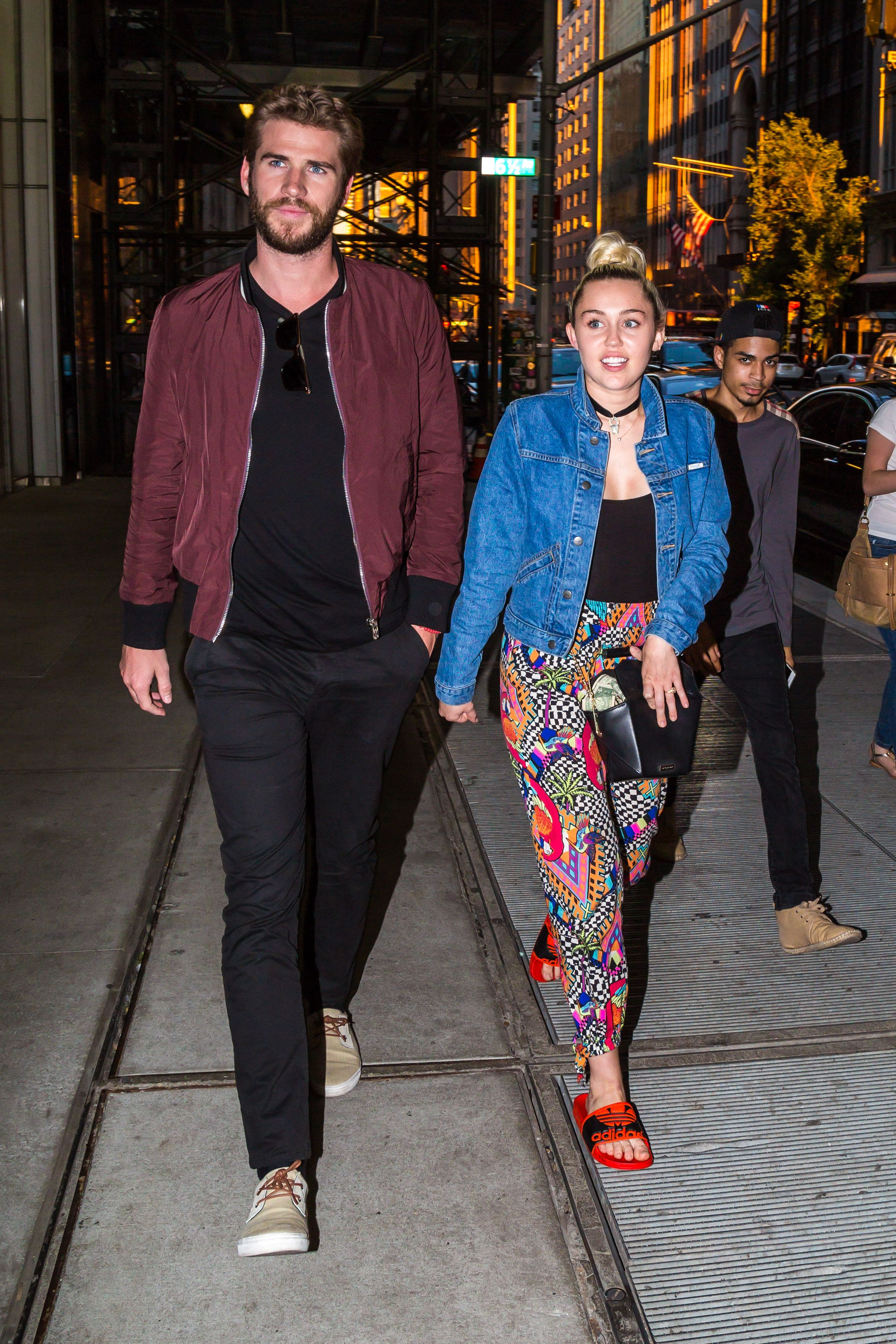 Miley Cyrus and Liam Hemsworth Have the Best Method for Dealing with the Paparazzi