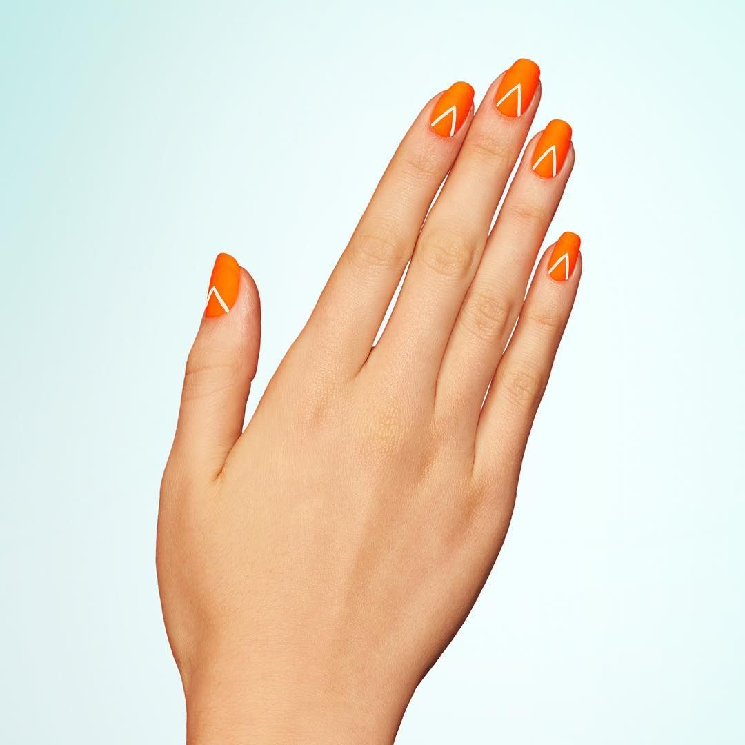 """<p>Start with a neon orange base, then add an inverted-V to each nail. Once dry, set the look with a matte topcoat. </p><p>Design by <a href=""""https://www.instagram.com/p/BGqMw9DmsM4/"""" target=""""_blank"""">@paintboxnails</a></p>"""