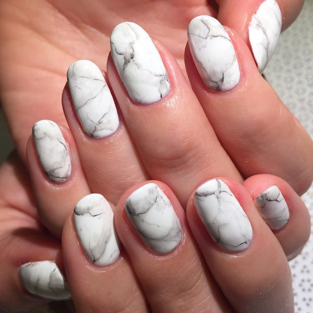 """<p>Instead of creating <a href=""""http://www.elle.com/beauty/makeup-skin-care/g28499/nail-art-designs-short-nails/"""" target=""""_blank"""">tie dyed nails</a> in bright neon, choose a realistic Carrera marble design. You can follow the same steps as a traditional marbled nail, or you can freeform the design by hand. Either way, use a paintbrush dipped in polish remover to gently blur the edges. Finish with a matte topcoat and voila, you're matching your kitchen tabletop. </p><p>Design by <a href=""""https://www.instagram.com/p/9ugEk4jOWq/"""" target=""""_blank"""">rosebnails</a><br></p>"""