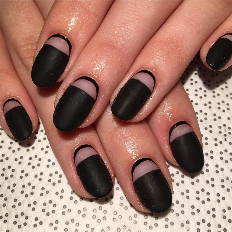 """<p>Or, reverse the design of the last nail for this design. Start by taping off your half moon. Add a matte black polish and wait to dry. Remove the tape, then outline the base of your nail in the same color. </p><p>Design by <a href=""""https://www.instagram.com/p/BB1AWEXDOU2/"""" target=""""_blank"""">@rosebnails</a></p>"""