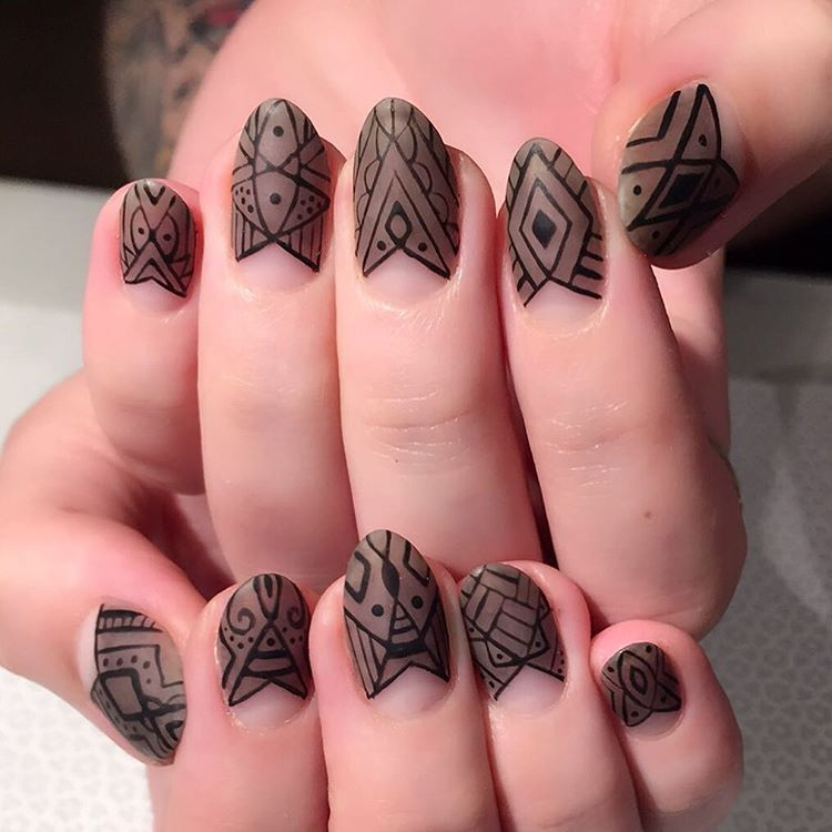 """<p>Tape off your half moon in a triangle shape. Paint a taupe matte polish and let dry. Use a thin brush to add linear details.</p><p>Design by <a href=""""https://www.instagram.com/p/BHUboYAhdef/"""" target=""""_blank"""">@vanityprojects</a></p>"""