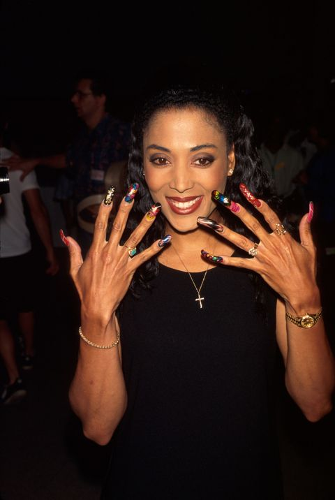 <p>Flo Jo won five Olympic medals for track and field, and broke a world record for the 100-meter dash. She also inspired generations of women to combine strength <em>and </em>beauty by pairing her track uniform with famously glamazon nails.<em></em></p>