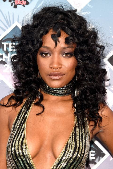 Hairstyle, Style, Black hair, Beauty, Ringlet, Jheri curl, Chest, Body jewelry, Model, Long hair,