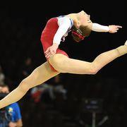 Human leg, Sportswear, Sports uniform, Entertainment, Gymnastics, Performing arts, Elbow, Competition event, Knee, Leotard,