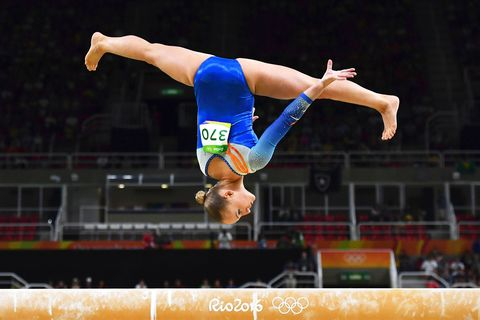 Human leg, Sports uniform, Elbow, Jumping, Wrist, Sportswear, Knee, Competition event, Muscle, Championship,