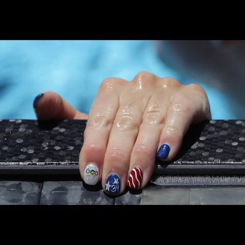 "<p>Let's kick this off with a literal nail look worn by an actual Olympic gold medalist, Allison Schmitt. To get her Team USA manicure, paint each nail with a glitter base and use a thin brush to paint the details. <em></em></p><p><em>Design by </em><a href=""https://www.instagram.com/p/BH_ydFdD3i1/"" target=""_blank"">@lovethisnailgirl</a><br></p>"