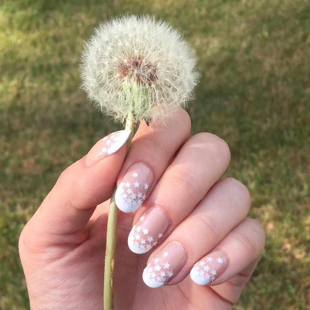 "<p>For this star-spangled design give yourself a classic french tip manicure. Once dry apply a clear coat and while it's still tacky apply white star decals to the ends. Let dry and seal with a clear topcoat. <br></p><p><em>Design by </em><a href=""https://www.instagram.com/p/BIlfSPTgrOe/q"" target=""_blank""><em>@primping_aint_easy</em></a></p>"