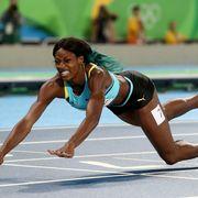 Sports uniform, Track and field athletics, Human leg, Shoe, Sportswear, Sport venue, Athlete, Sports, Competition event, Knee,