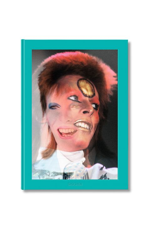"""<p><span class=""""redactor-invisible-space"""" data-verified=""""redactor"""" data-redactor-tag=""""span"""" data-redactor-class=""""redactor-invisible-space"""">The Thin White Duke was gone far too soon, and one of the best ways to pay tribute is this giant David Bowie book—<span class=""""redactor-invisible-space"""" data-verified=""""redactor"""" data-redactor-tag=""""span"""" data-redactor-class=""""redactor-invisible-space""""></span>released this year from Taschen—<span class=""""redactor-invisible-space"""" data-verified=""""redactor"""" data-redactor-tag=""""span"""" data-redactor-class=""""redactor-invisible-space""""></span>that features large-scale photographs of him by photographer Mick Rock&nbsp;at his most colorful moments&nbsp;on-stage and in his dressing room during the&nbsp;Ziggy Stardust era.&nbsp;</span></p><p><strong data-redactor-tag=""""strong"""" data-verified=""""redactor""""><em data-redactor-tag=""""em"""" data-verified=""""redactor"""">Mick Rock: The Rise of David Bowie, 1972-1973</em>, $48; <a href=""""http://www.barnesandnoble.com/w/mick-rock-mick-rock/1123289737?ean=9783836560948&amp;st=PLA&amp;sid=BNB_DRS_Core+Shopping+Books_00000000&amp;2sid=Google_&amp;sourceId=PLGoP737&amp;k_clickid=3x737"""" target=""""_blank"""">barnesandnoble.com</a>.</strong></p>"""