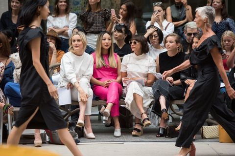 Eyewear, Vision care, People, Trousers, Social group, Style, Crowd, Fashion accessory, Sitting, Street fashion,