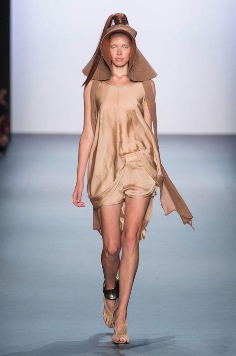 Brown, Skin, Shoulder, Fashion show, Human leg, Joint, Dress, Fashion model, Style, Runway,