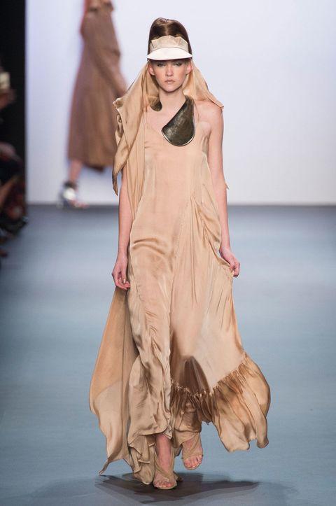 Skin, Fashion show, Shoulder, Human leg, Joint, Runway, Style, Fashion model, Dress, Fashion,