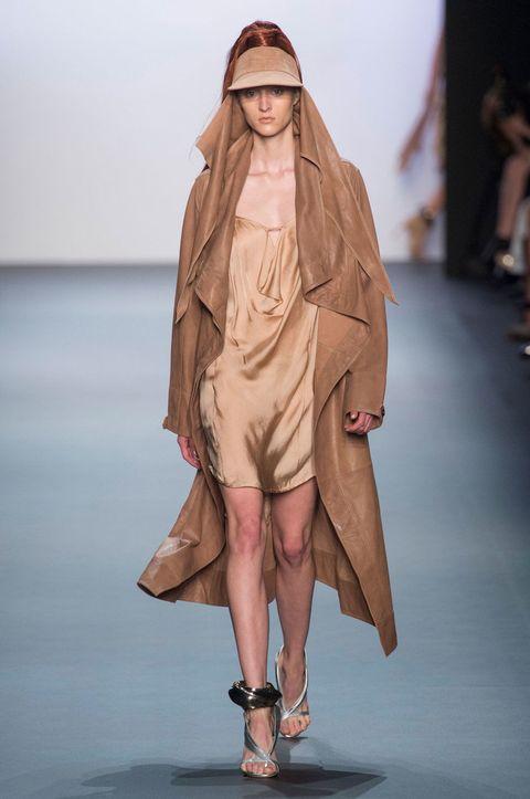 Shoulder, Fashion show, Human leg, Joint, Outerwear, Runway, Fashion model, Wrap, Fashion, Sandal,