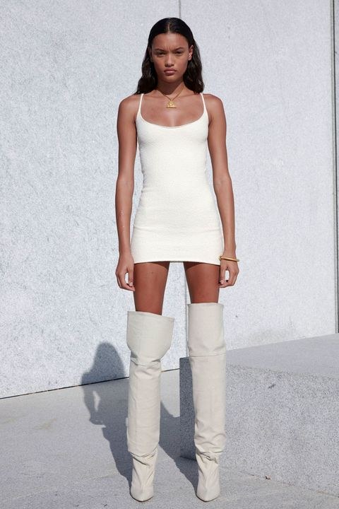 Shoulder, Human leg, Joint, White, Style, Knee, Street fashion, Sleeveless shirt, Fashion model, Boot,