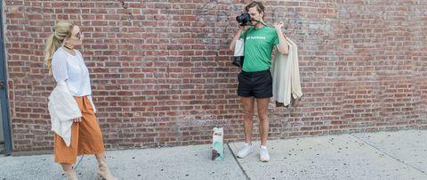 Camera, Brick, Street fashion, Brickwork, Photography, Photographer, Walking, Digital camera, Video camera, Cameras & optics,