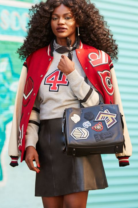 """<p>A varsity jacket is laid-back by default, so to avoid looking sloppy, Gold balances it with other pieces that impart edgy elegance, like a leather skirt. """"Ankle boots keep the skirt casual,"""" she adds. """"They're functional, but polished."""" Gold also recommends topping the skirt with a cozy sweatshirt and skipping statement jewelry. """"Tie a bandana around your neck instead,"""" she says. """"You'll look like a rock star—like you're <em data-redactor-tag=""""em"""">in</em> the band."""" </p><p><br> </p><p><em data-redactor-tag=""""em"""">Coach 1941 Oversized Varsity Jacket, $1,195, <a rel=""""noskim"""" href=""""http://www.coach.com/coach-designer-vest-oversized-varsity-jacket/56368.html?CID=D_B_ELL_11733"""" target=""""_blank"""">coach.com</a>; Coach <em data-redactor-tag=""""em"""">1941 </em><span class=""""redactor-invisible-space"""" data-verified=""""redactor"""" data-redactor-tag=""""span"""" data-redactor-class=""""redactor-invisible-space""""></span>Embellished 41 Sweatshirt, $350, <a rel=""""noskim"""" href=""""http://www.coach.com/coach-designer-tops-embellished-41-sweatshirt/57140.html?CID=D_B_ELL_11734"""" target=""""_blank"""">coach.com</a>; Coach <em data-redactor-tag=""""em"""">1941 </em><span class=""""redactor-invisible-space"""" data-verified=""""redactor"""" data-redactor-tag=""""span"""" data-redactor-class=""""redactor-invisible-space""""></span>Leather A-Line Skirt, $695, <a rel=""""noskim"""" href=""""http://www.coach.com/coach-designer-pants-leather-a-line-skirt/56692.html?CID=D_B_ELL_11735"""" target=""""_blank"""">coach.com</a>; <em data-redactor-tag=""""em"""">Coach <em data-redactor-tag=""""em"""">1941 </em><span class=""""redactor-invisible-space"""" data-verified=""""redactor"""" data-redactor-tag=""""span"""" data-redactor-class=""""redactor-invisible-space""""></span>Chelsea Boot, $575, </em><em data-redactor-tag=""""em""""><a rel=""""noskim"""" href=""""http://www.coach.com/coach-designer-booties-chelsea-boot/Q8919.html?CID=D_B_ELL_11736"""" target=""""_blank"""">coach.com</a>;</em> Coach <em data-redactor-tag=""""em"""">1941 </em><span class=""""redactor-invisible-space"""" data-verified=""""redactor"""" data-redactor-tag=""""span"""" data-redactor-c"""