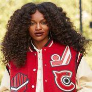 Hairstyle, Jheri curl, Jersey, Sportswear, Uniform, Ringlet, Sports jersey, Black hair, Beauty, Jacket,