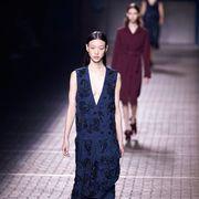 Fashion show, Human body, Dress, Standing, Runway, Fashion model, Street fashion, Fashion, Waist, One-piece garment,