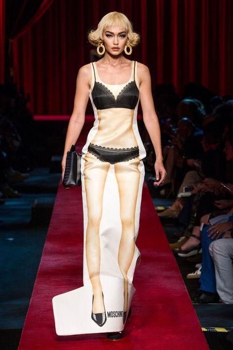 Fashion show, Shoulder, Human leg, Runway, Fashion model, Waist, Trunk, Fashion, Thigh, Model,