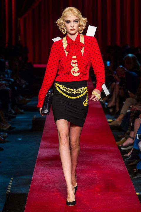 Fashion show, Red, Runway, Joint, Outerwear, Human leg, Fashion model, Style, Flooring, Jewellery,