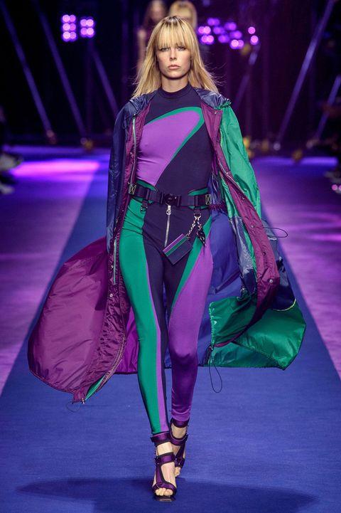 Fashion show, Fashion model, Runway, Purple, Fashion, Model, Costume design, Public event, Long hair, Fashion design,