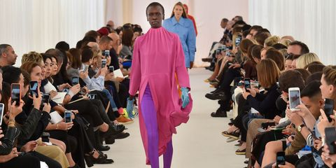 Footwear, Event, Fashion show, Runway, Curtain, Fashion model, Fashion, Public event, Fashion design, Audience,