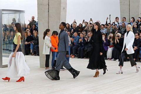 Footwear, Event, Crowd, Dress, Tradition, Crew, Little black dress, One-piece garment,