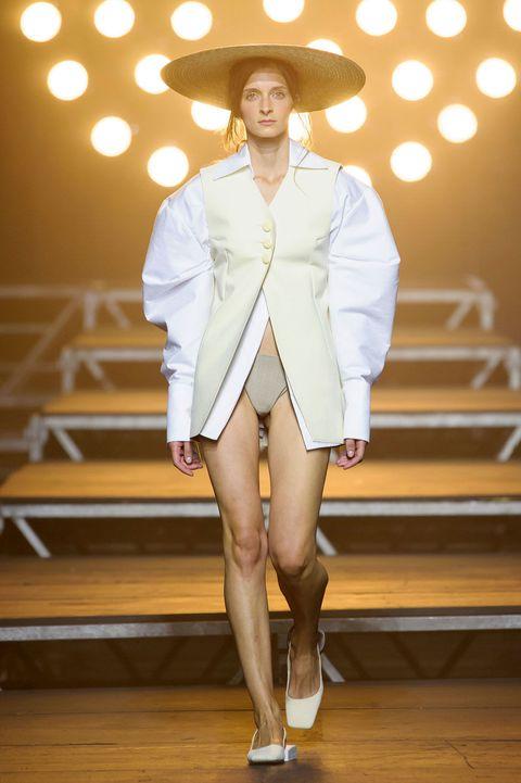Clothing, Sleeve, Hat, Human leg, Fashion show, Outerwear, Fashion model, Style, Runway, Knee,