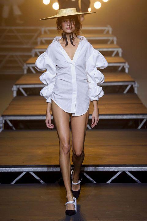 Leg, Human leg, Fashion show, Runway, Outerwear, Style, Stairs, Fashion model, Hat, Knee,