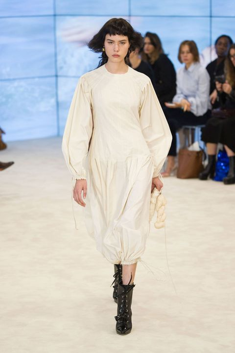 Clothing, Human, Skin, Fashion show, Shoulder, Joint, Outerwear, Runway, Dress, Style,