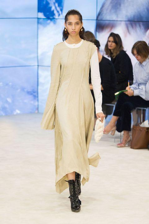 Human body, Fashion show, Shoulder, Dress, Joint, Runway, Style, Fashion model, Formal wear, One-piece garment,