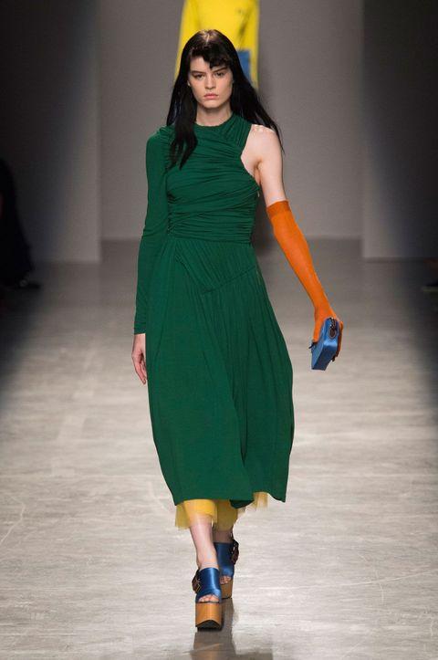 Yellow, Sleeve, Shoulder, Dress, Joint, Human leg, One-piece garment, Floor, Formal wear, Flooring,