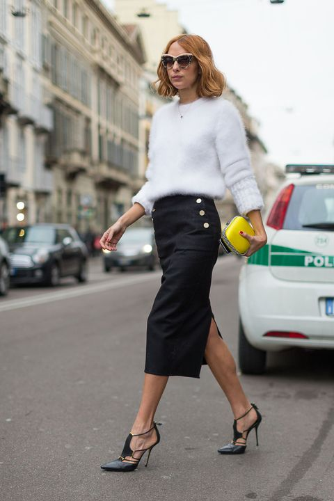 <p>Pencil skirts are a workwear mainstay, but the version getting snapped by street style photographers is extra-special thanks to a subtle glint provided by sailor-inspired buttons. Sub in a fuzzy sweater and sexy heels for the typical blouse and pump.</p>