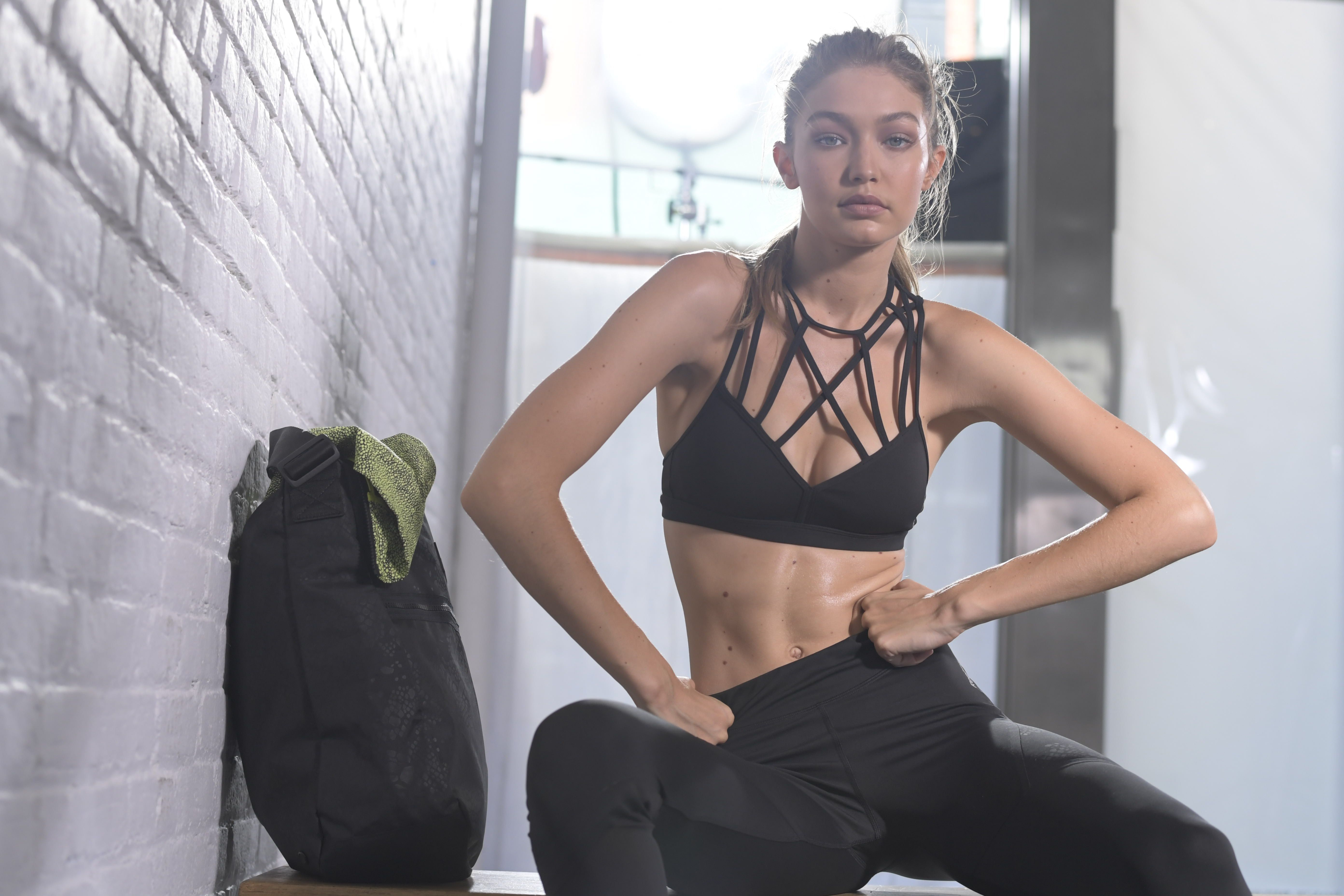 08605ec68 Gigi Hadid Hates the Gym, Loves Carbs, and Just Got Her First Fitness  Campaign