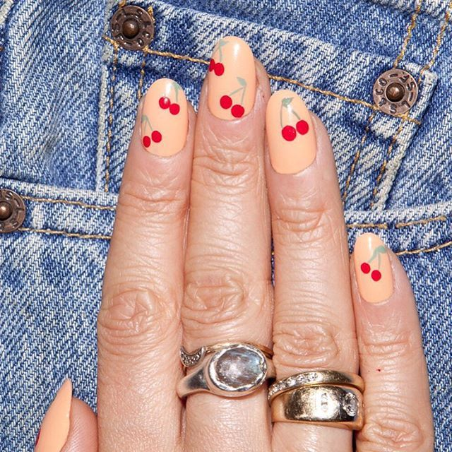 """<p>Alternatively, use a pop of red on a neutral background. To get thischerry design, start with a nude base. Add pairs of red dots throughout, then use a thin brush to paint stems and leaves in green. Finish it off with a clear topcoat.</p><p><em data-redactor-tag=""""em"""" data-verified=""""redactor"""">Design by</em><a href=""""https://www.instagram.com/p/9o9HgNNShS/""""><em data-redactor-tag=""""em"""" data-verified=""""redactor"""">@aliciatnails</em></a></p>"""