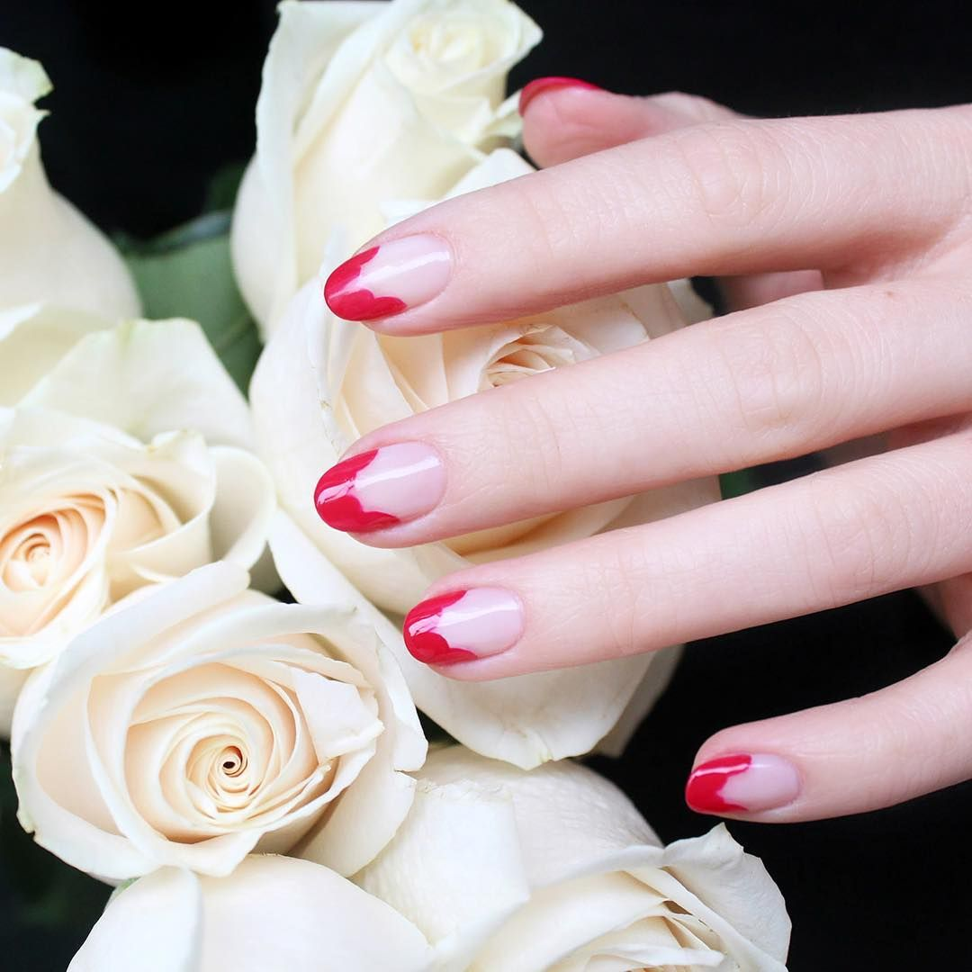 """<p>Instead of painting a red French tip, scallop the inside edge for an abstract floral design.</p><p><em data-redactor-tag=""""em"""" data-verified=""""redactor"""">Design by<span class=""""redactor-invisible-space"""" data-verified=""""redactor"""" data-redactor-tag=""""span"""" data-redactor-class=""""redactor-invisible-space""""></span></em><a href=""""https://www.instagram.com/p/BFKJJR4qRhK/""""><em data-redactor-tag=""""em"""" data-verified=""""redactor"""">@jinsoon</em></a><br></p>"""