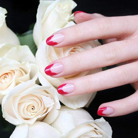 "<p>Instead of painting a red French tip, scallop the inside edge for an abstract floral design.&nbsp;</p><p><em data-redactor-tag=""em"" data-verified=""redactor"">Design by&nbsp;<span class=""redactor-invisible-space"" data-verified=""redactor"" data-redactor-tag=""span"" data-redactor-class=""redactor-invisible-space""></span></em><a href=""https://www.instagram.com/p/BFKJJR4qRhK/""><em data-redactor-tag=""em"" data-verified=""redactor"">@jinsoon</em></a><br></p>"
